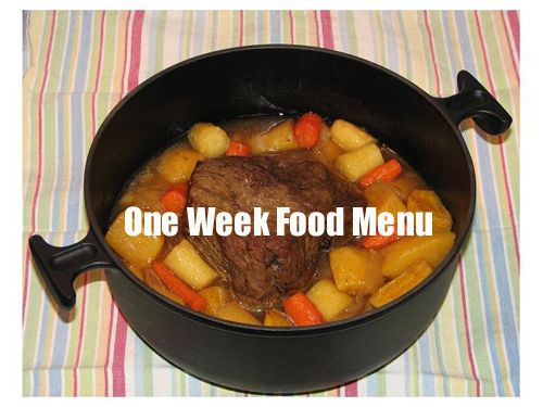 Pot roast surrounded by potatoes and carrots