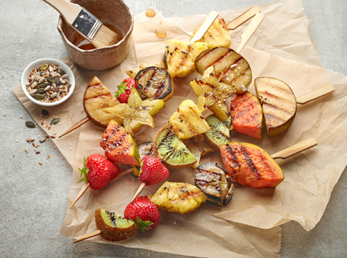 grilled fruit pieces on wooden skewers