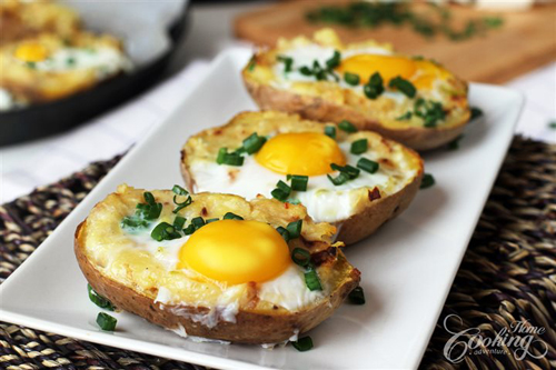 Open faced potatoes with eggs on it